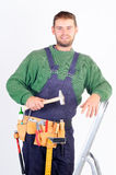 Real carpenter standing on a ladder Stock Images