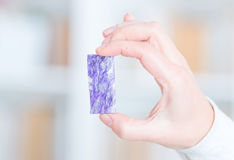 Real charoite in hand Royalty Free Stock Images