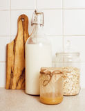 Real comfort wooden kitchen with breakfast ingredients close up in glass, honey, oatmeal, milk, muesli Stock Images