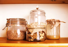 Real comfort wooden kitchen with breakfast ingredients close up in glass, honey, oatmeal, milk, muesli Royalty Free Stock Images