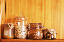 Real comfort wooden kitchen with breakfast ingredients close up in glass, honey, oatmeal, milk, muesli Stock Image