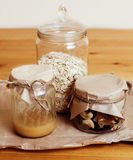 Real comfort wooden kitchen with breakfast ingredients close up in glass, honey, oatmeal, milk, muesli Stock Photo