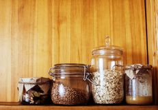 Real comfort wooden kitchen with breakfast ingredients close up Stock Images