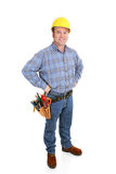Real Construction Worker - Confident. Authentic construction worker dressed for the job.  Full body isolated on white Royalty Free Stock Image