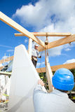 Real construction workers. Construction workers at work with wooden  roof construction of a new home Stock Images