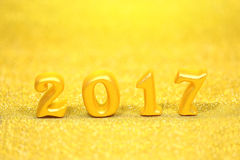 2017 real 3d objects on gold glitter background, happy new year concept royalty free stock photo