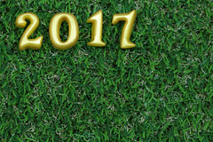 2017 real 3d objects on green grass, happy new year concept Stock Photos
