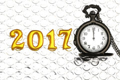 2017 real 3d objects on reflection foil with luxury pocket watch, happy new year concept Stock Image