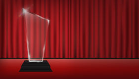 Real 3d transparent acrylic trophy with red curtain stage background. A real 3d transparent acrylic trophy with red curtain stage background Royalty Free Stock Photos