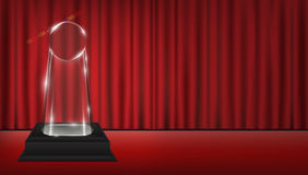 Real 3d transparent acrylic trophy with red curtain stage background. A real 3d transparent acrylic trophy with red curtain stage background Royalty Free Stock Image