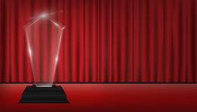 Real 3d transparent acrylic trophy with red curtain stage background. A real 3d transparent acrylic trophy with red curtain stage background Stock Image