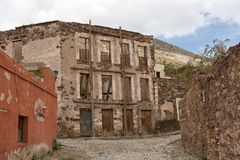 Real de Catorce, Mexico abandoned buildings. May 22, 2014 Real de Catorce, Mexico: narrow cobblestone streets and mostly abandoned stone buildings all through Royalty Free Stock Photos