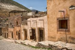 Real de Catorce Mexico abandoned silver town. May 22, 2014 Real de Catorce, Mexico: narrow cobblestone streets and mostly abandoned stone buildings all through Royalty Free Stock Photography