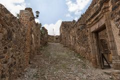 Real de Catorce Mexico abandoned silver town. May 22, 2014 Real de Catorce, Mexico: the stone built houses along the cobblestone streets are mostly abandoned an Royalty Free Stock Photography
