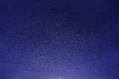 Real Deep Indigo Color Paper Texture. Deep indigo colored paper showing texture and light gradient Royalty Free Stock Photo
