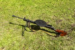 Real Degtyarev machine gun the legendary weapon of USSR. Real Degtyarev combat machine gun on the grass - a victorious and reliable legendary weapon of the USSR royalty free stock photo