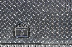 Real diamond plate with lock Stock Images