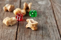 Real dice. Knuckle bones and gaming pieces. Ancient game with la Stock Photography
