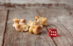 Real dice. Knuckle bones and gaming pieces. Ancient game with la Royalty Free Stock Photos