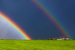 Real double rainbow. Beautiful real double rainbow and green field Stock Photo