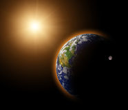 Real Earth Planet in yellow sun. Rays Stock Photos