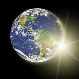 Real Earth Planet in yellow sun Stock Images