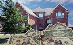 Real Estate. A typical american house with dollar bills in the foreground Royalty Free Stock Photo