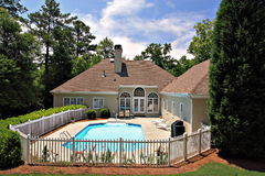 Real Estate. Back yard with enclosed  pool Royalty Free Stock Images
