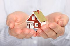 Real estate. Real estate cocnept. Small house in female hands Royalty Free Stock Images