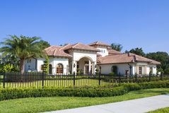 Real Estate. Upscale home in Central Florida with blue sky royalty free stock image