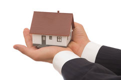 Real estate. Concept, businessman holding mini house Stock Photos