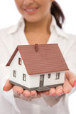 Real estate. Concept with businesswoman holding a mini house Royalty Free Stock Photography