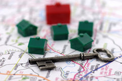Real Estate. Photo of a Key, Map and Houses
