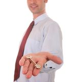 Real estate. Agent showing a key of a new house stock images