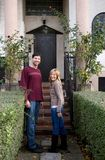 Real estate. Young couple in love in front of a new house royalty free stock photo