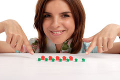 Real estate. Pretty young woman playing with toy houses, real estate Stock Photo