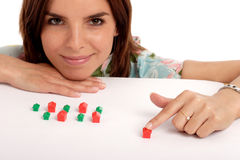 Real estate. Pretty young woman playing with toy houses, real estate Stock Image
