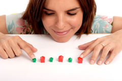 Real estate. Pretty young woman playing with toy houses, real estate Royalty Free Stock Images