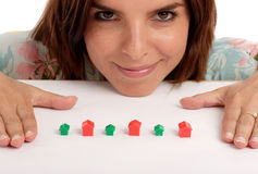 Real estate. Pretty young woman playing with toy houses, real estate Royalty Free Stock Photos