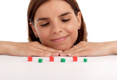 Real estate. Pretty young woman playing with toy houses, real estate royalty free stock photo