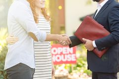 Real estate advisor congratulating clients. Close-up of real estate advisor congratulating young clients for buying a new home Royalty Free Stock Photo