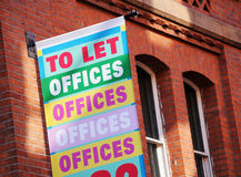 Real estate agency. Offices to let - letting and estate agency advert on red brick building Stock Images