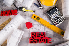 Real estate agency concept and blueprints Stock Photography