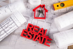 Real estate agency concept and blueprints Stock Image