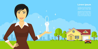 Real estate agency. Picture of smiling woman holding keys on her hand, with house building on background, real estate advertisement banner Royalty Free Stock Photos