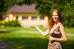 Real Estate Agent. Smiles near new house for sale royalty free stock photo
