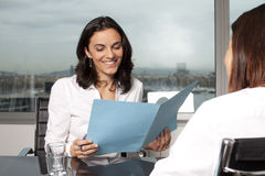 Real Estate Agent. With client in her office Stock Image