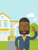 Real estate agent. An african-american real estate agent with beard and glasses holding key on house background vector flat design illustration. Vertical layout royalty free illustration