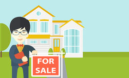 Real estate agent. An asian real estate agent in glasses holding the document and placard for sale on house background vector flat design illustration royalty free illustration