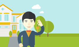 Real estate agent. An asian real estate agent holding key on house background vector flat design illustration. Horizontal layout with a text space vector illustration